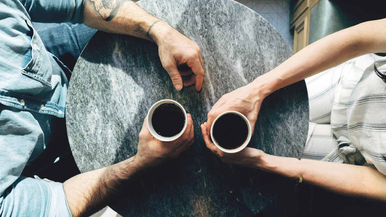aerial view of couple with coffees