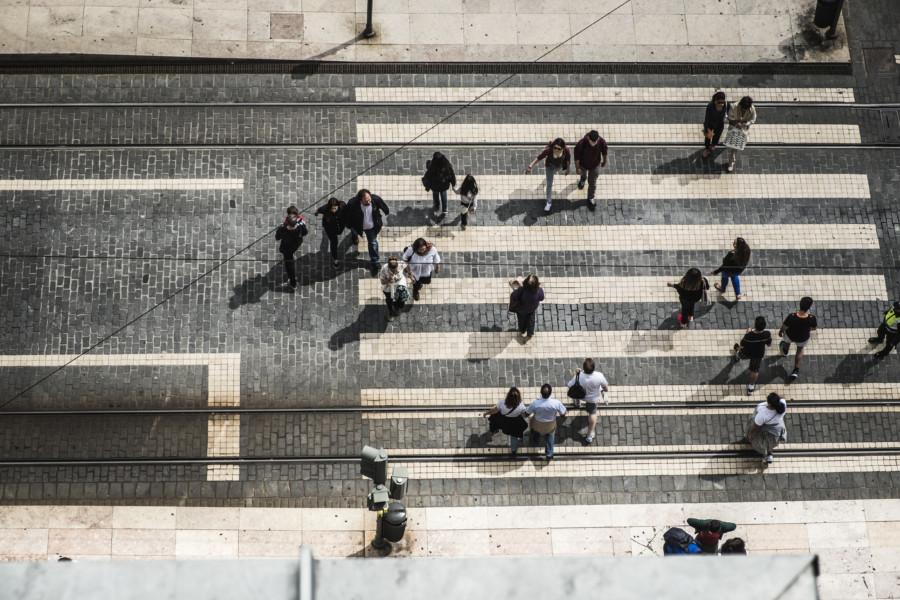 Pedestrians crossing road aerial view
