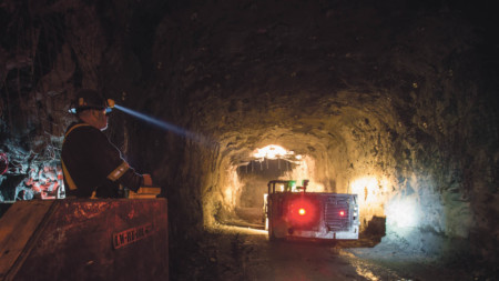 Mine worker with head torch