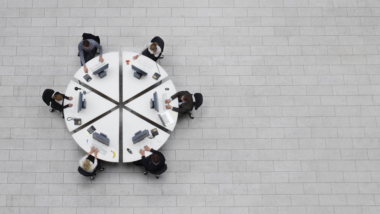 Staff sat at round table aerial view