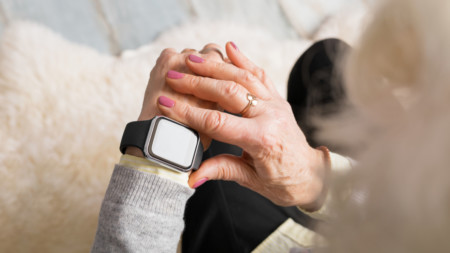 Elderly woman using Apple Watch
