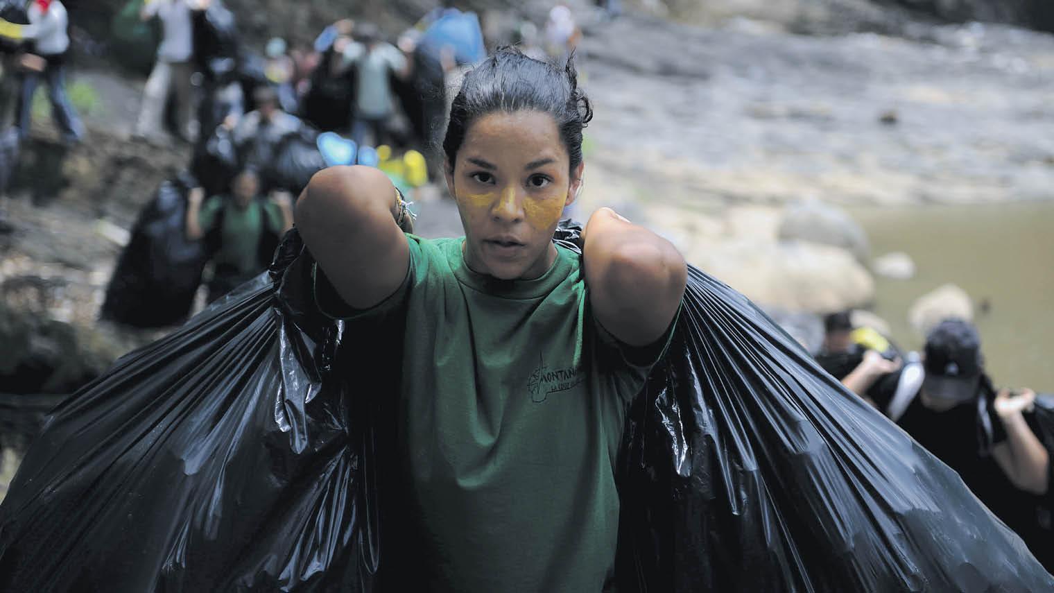 Volunteer clearing plastic waste Costa Rica