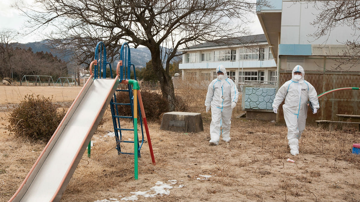 Workers in protective clothing after the Fukushima disaster