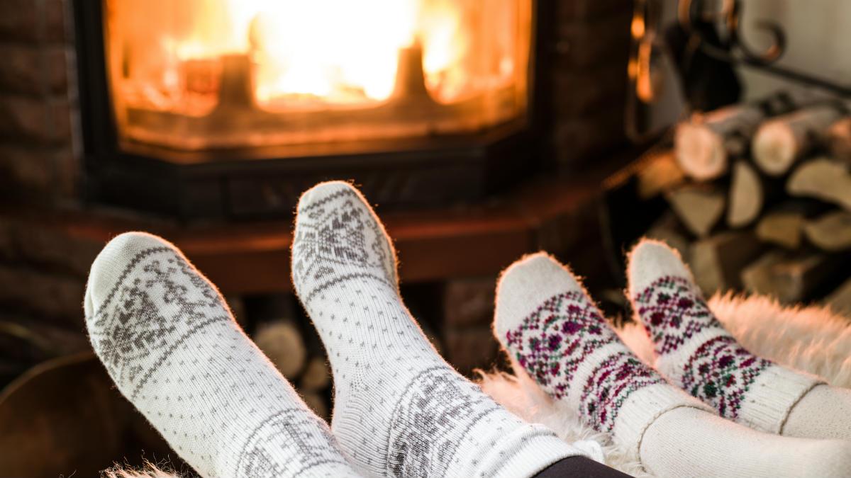 feet in socks in front of fire