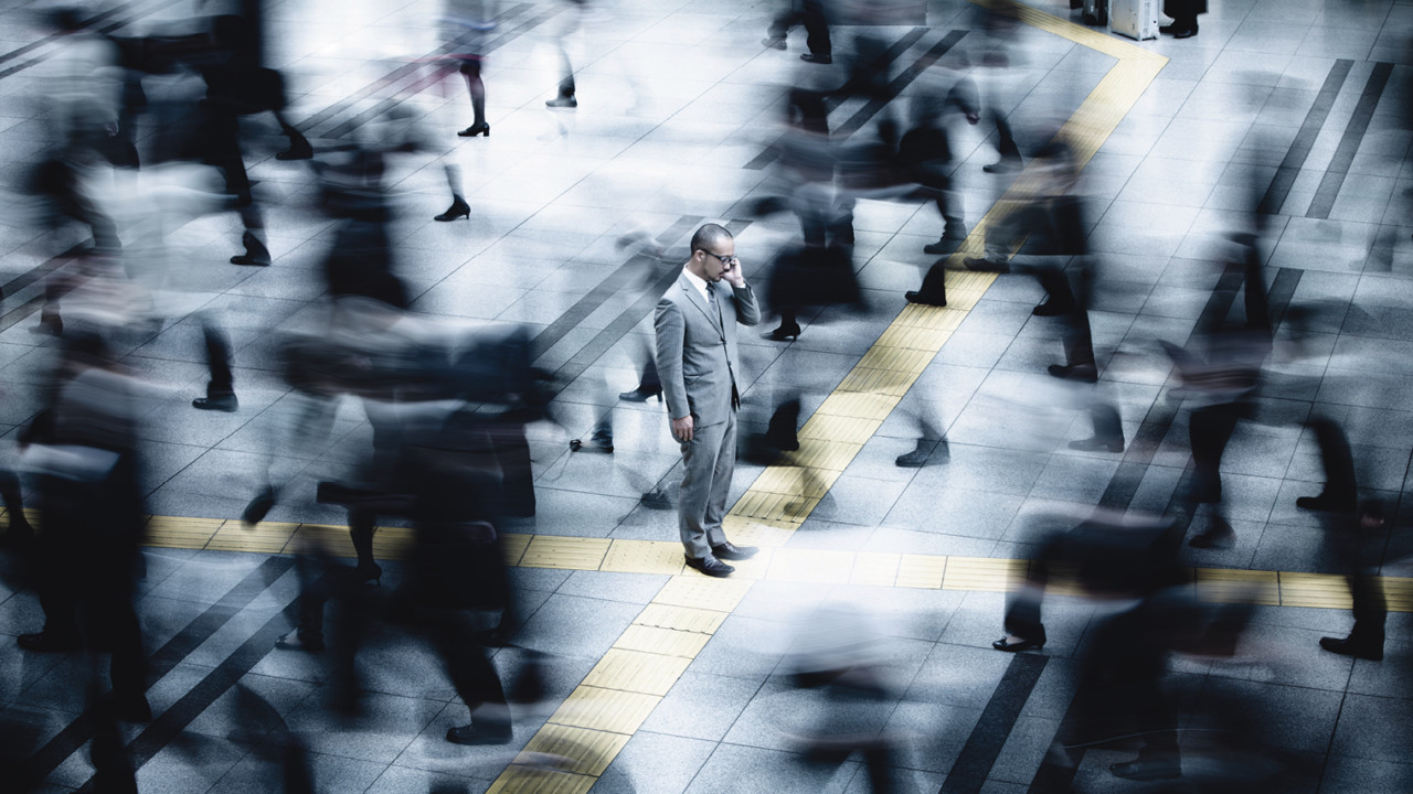 Man in crowded area long exposure