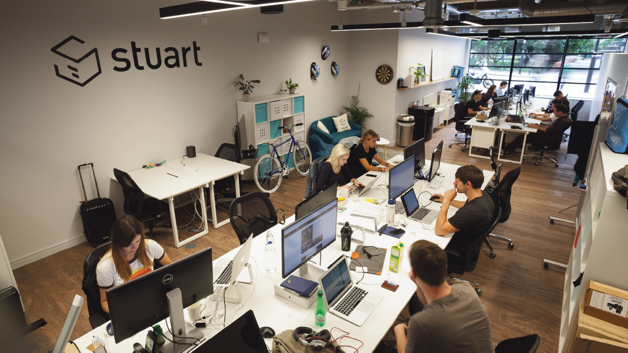 People working in open plan office