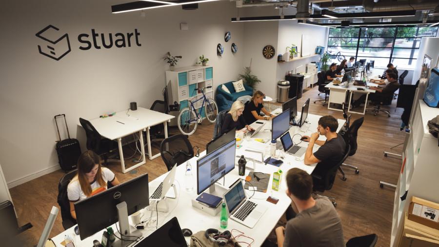 People working in open plan office