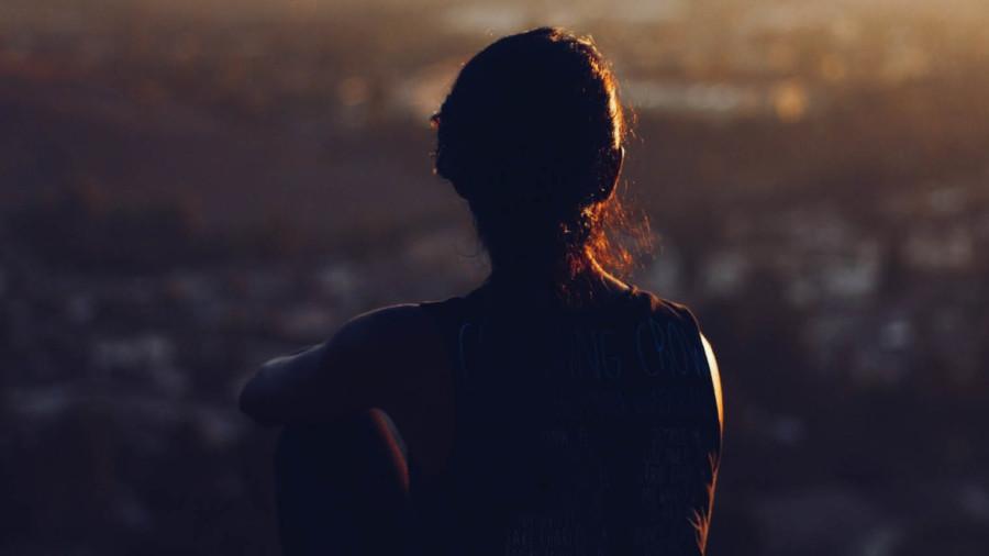 Woman sat looking at view