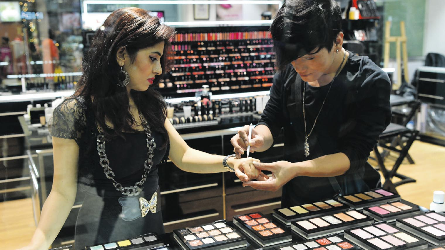 Beauty store assistant and client