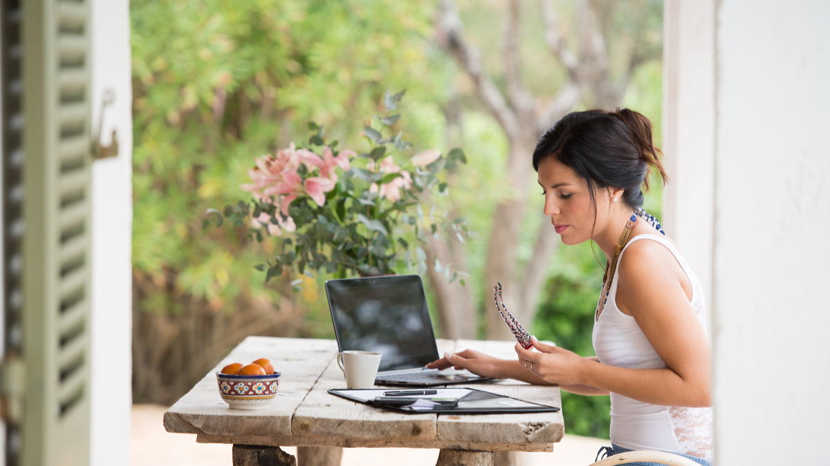 Woman working at desk outside