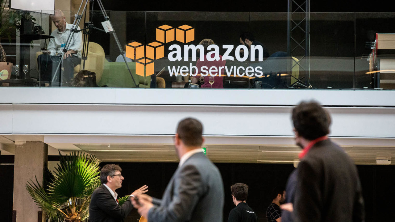 Workers outside Amazon web services office