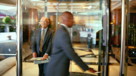 Senior exiting a revolving door