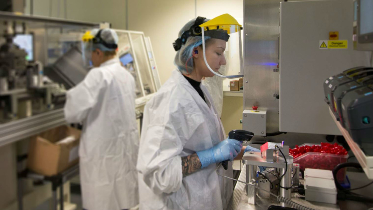 Two employees in an engineering clean room