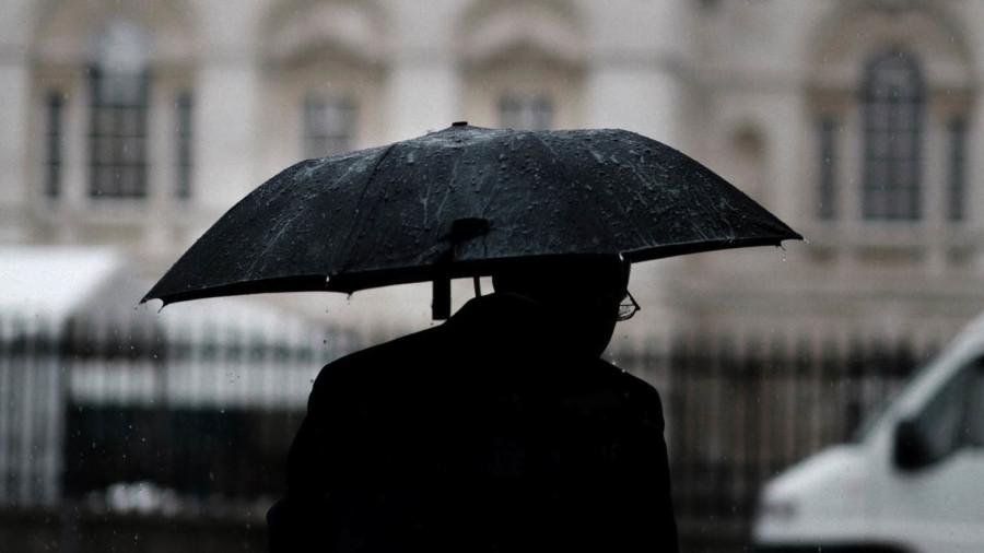 Man with umbrella black and white