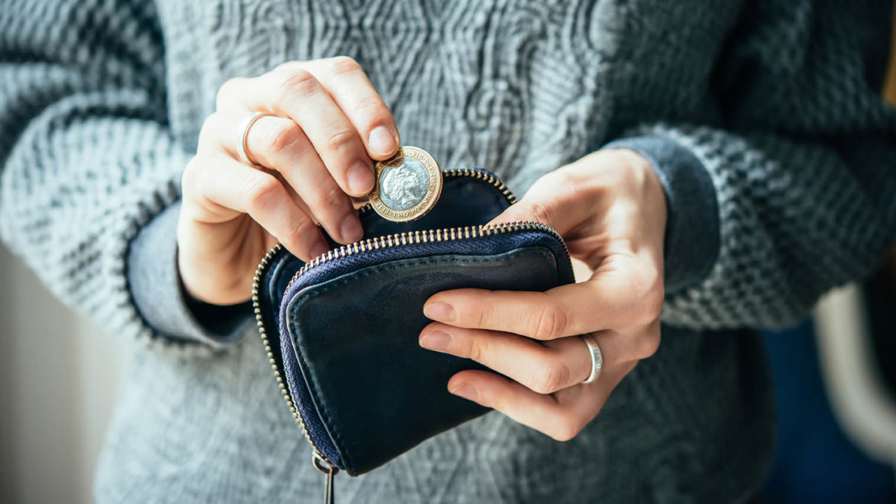 Woman with cash in purse