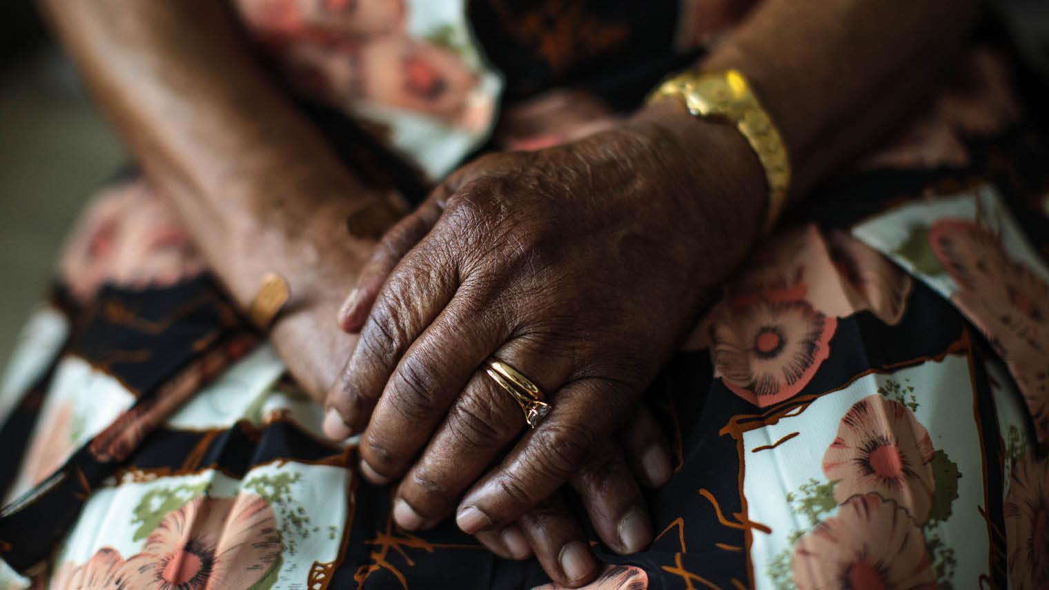 Elderly woman's hands in lap