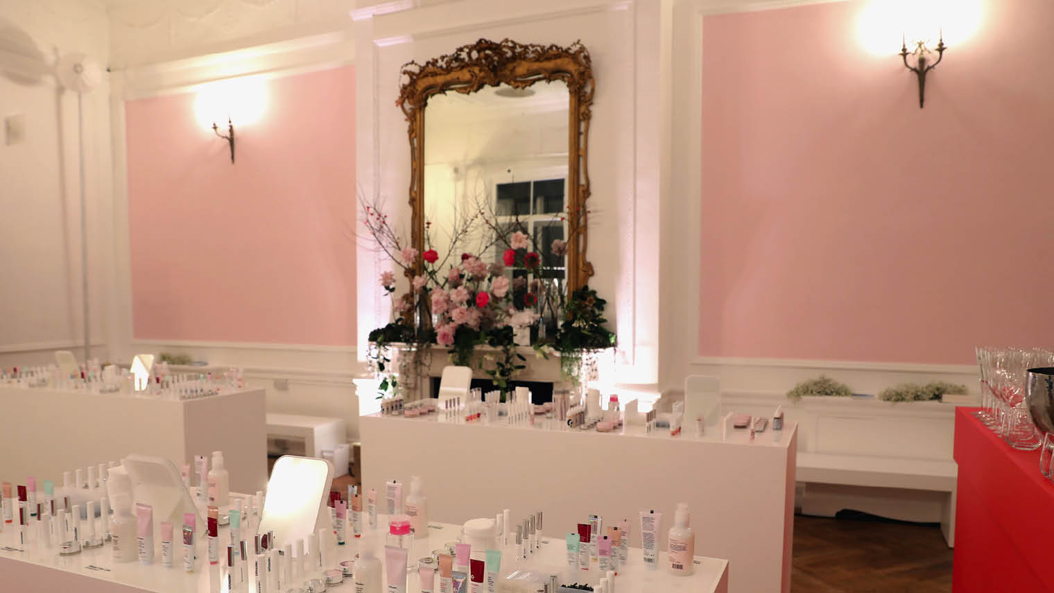 Glossier interactive brand experience with make up laid on tables