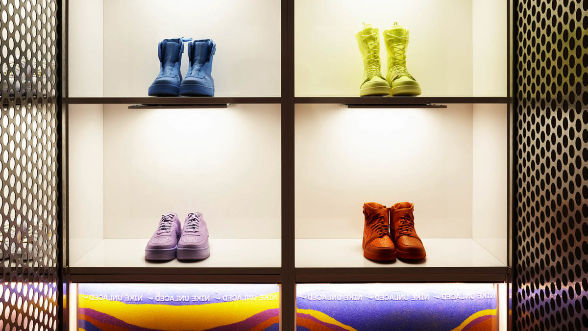 Colourful trainers on shelf in NIKE Unlaced interactive brand experience