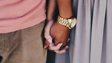 Close up couple holding hands