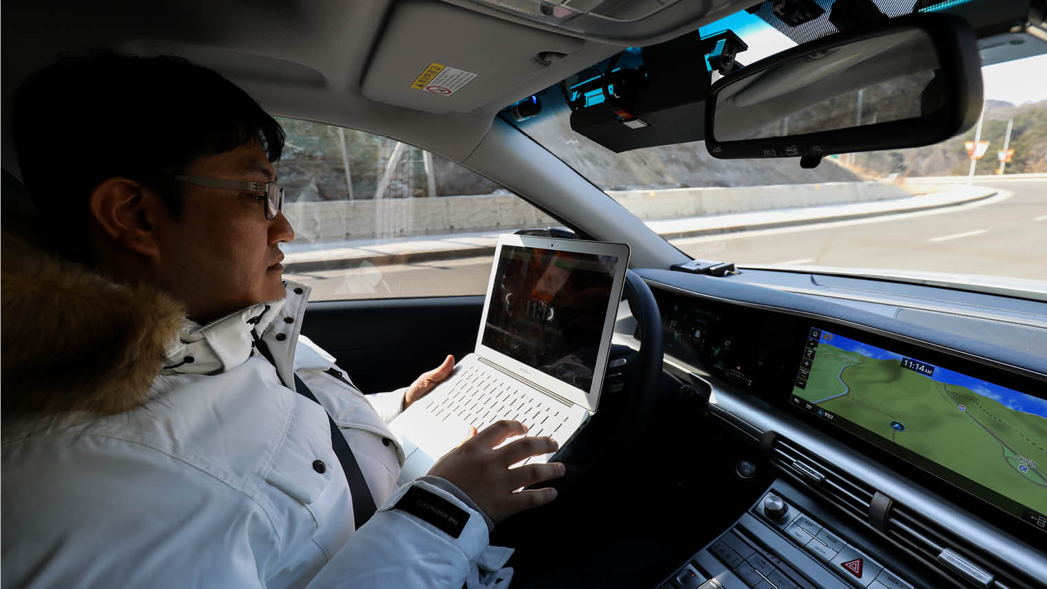 Hyundai engineer trialling a Nexo autonomous vehicle during a test drive in Pyeongchang, South Korea