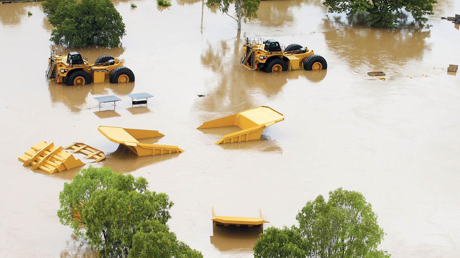 Submerged mining equipment under flood water in Rockhampton, Australia in 2011