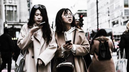 Women on oxford street using phones
