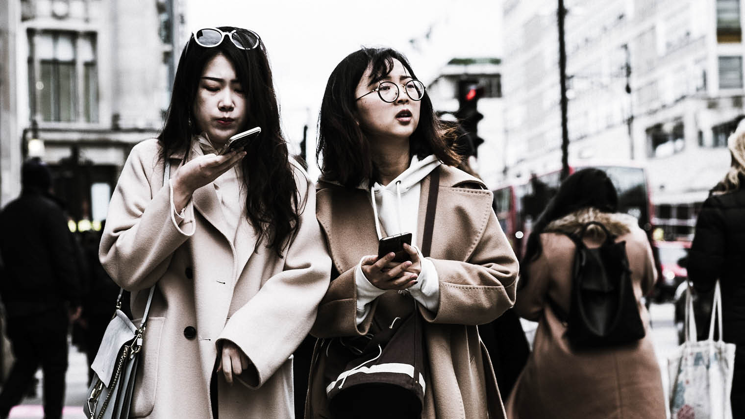 Women on oxford street using phones