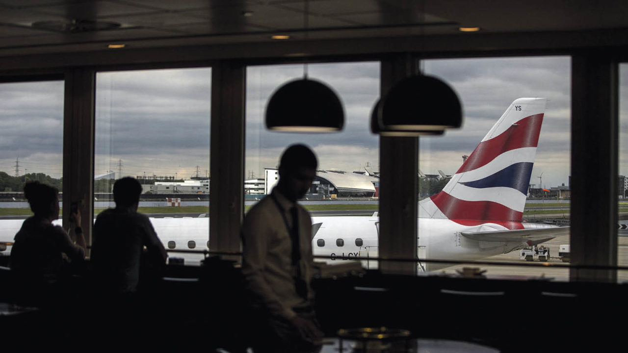 airport lounge with British airways plane visible through window Brexit