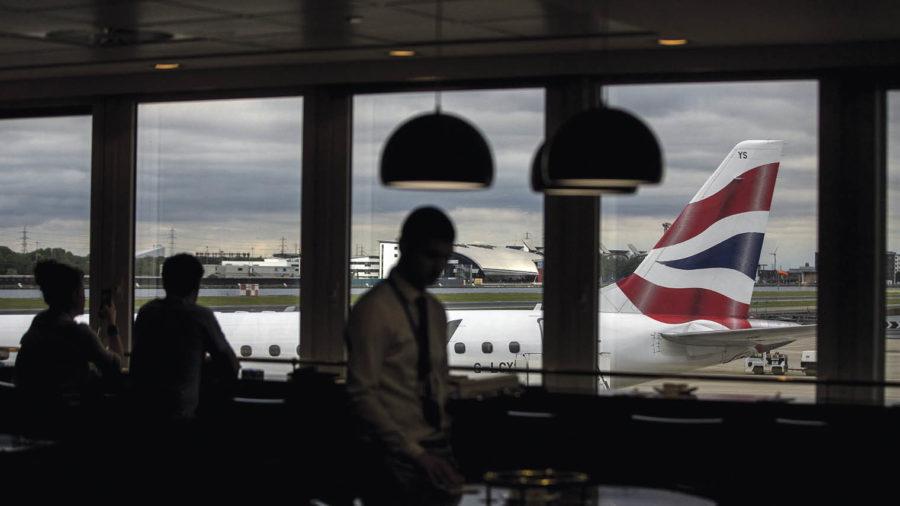 airport lounge with British airways plane visible through window Brexit