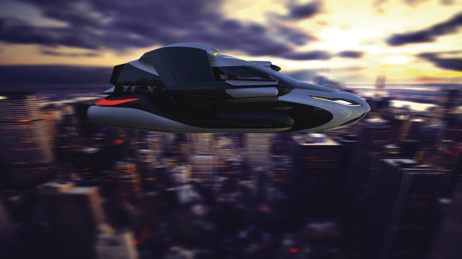 Terrafugia flying taxi car in front of blurred city scape