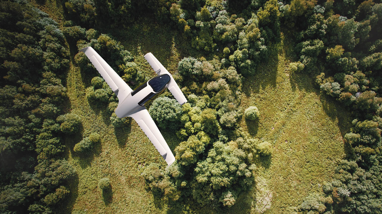 Bird's eye view of Lilium Jet five-seater plane over grass and trees