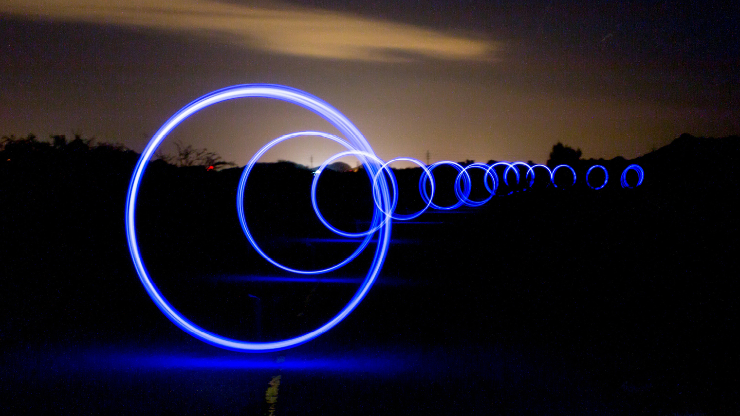 unstructured data Loops of light against night sky