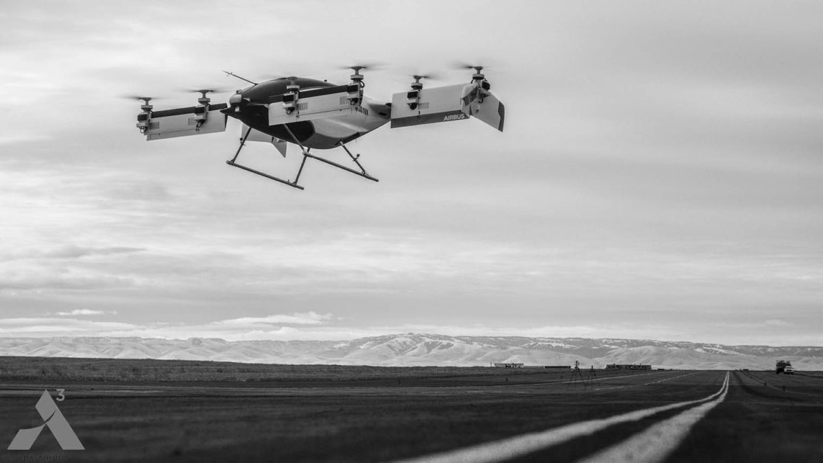 Future modes of transport: black and white autonomous helicopter over landscape
