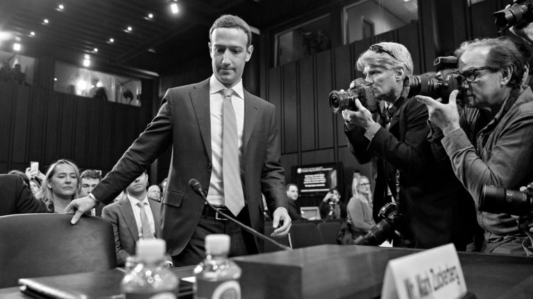 black and white Mark Zuckerberg being photographed in court
