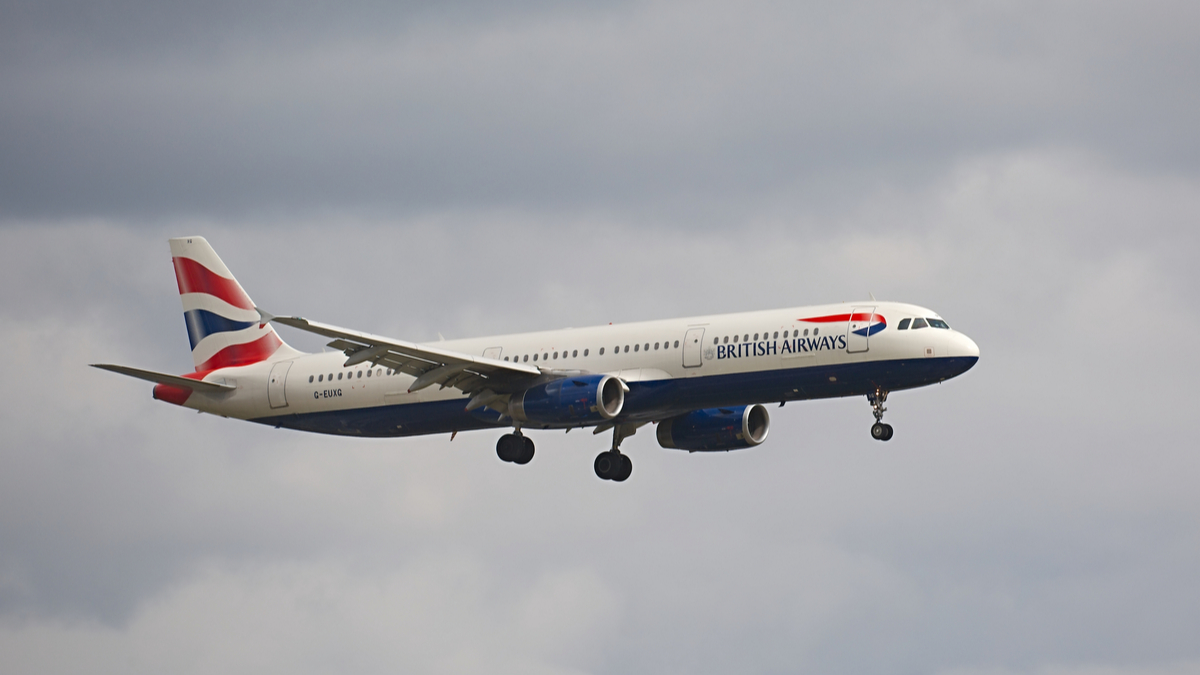 airlines British airways plane against grey clouds