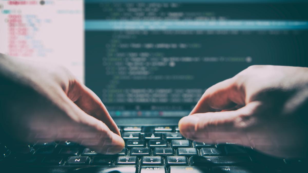 Hands on keyboard typing code, hacker,
