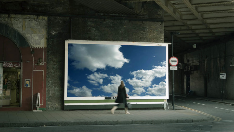 digital agencies woman on street passing billboard