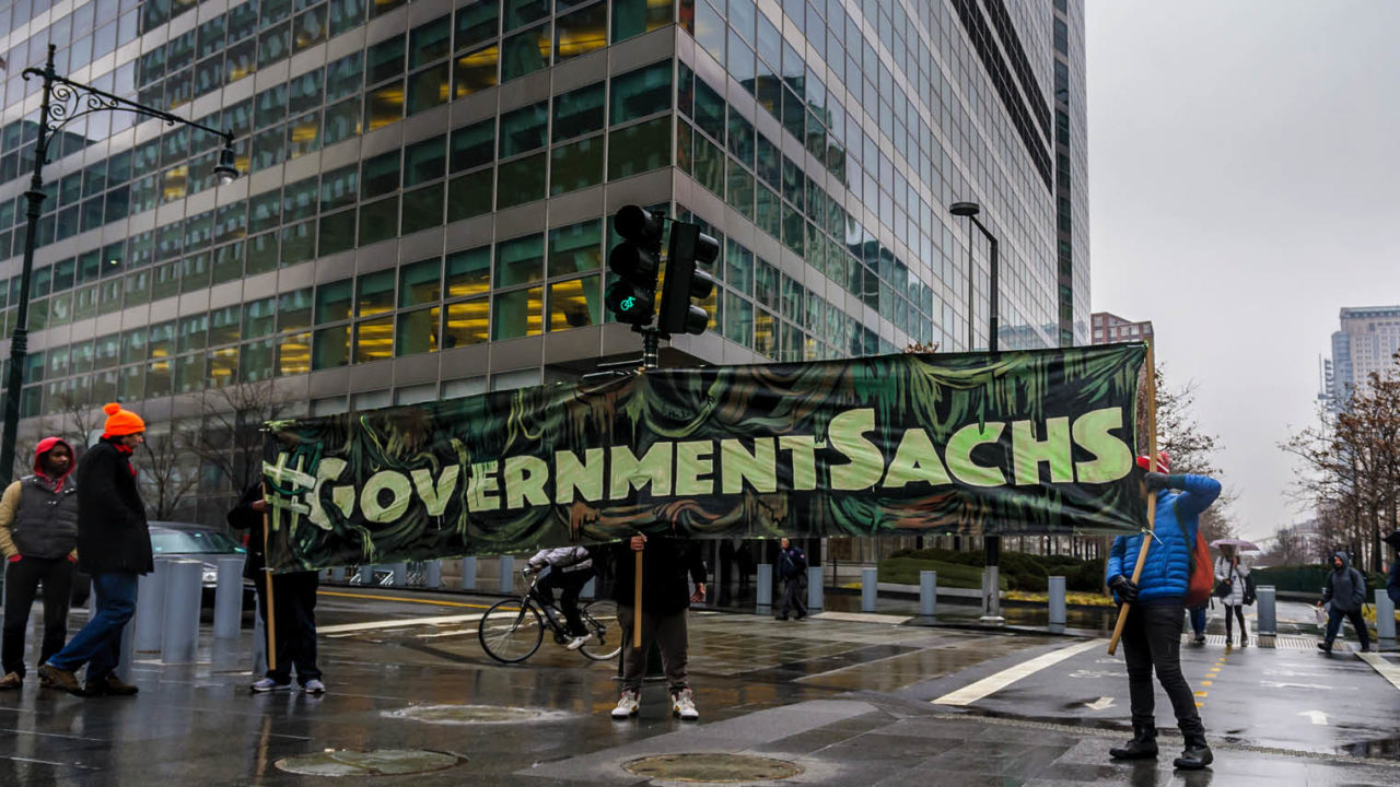 activists campaigning against Goldman Sachs conflict of interest