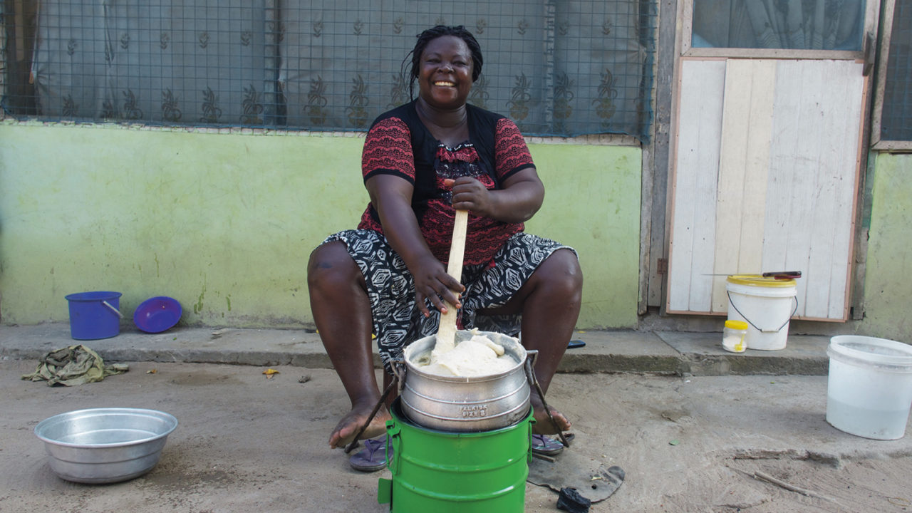 impact investing scheme woman at eco-friendly stove
