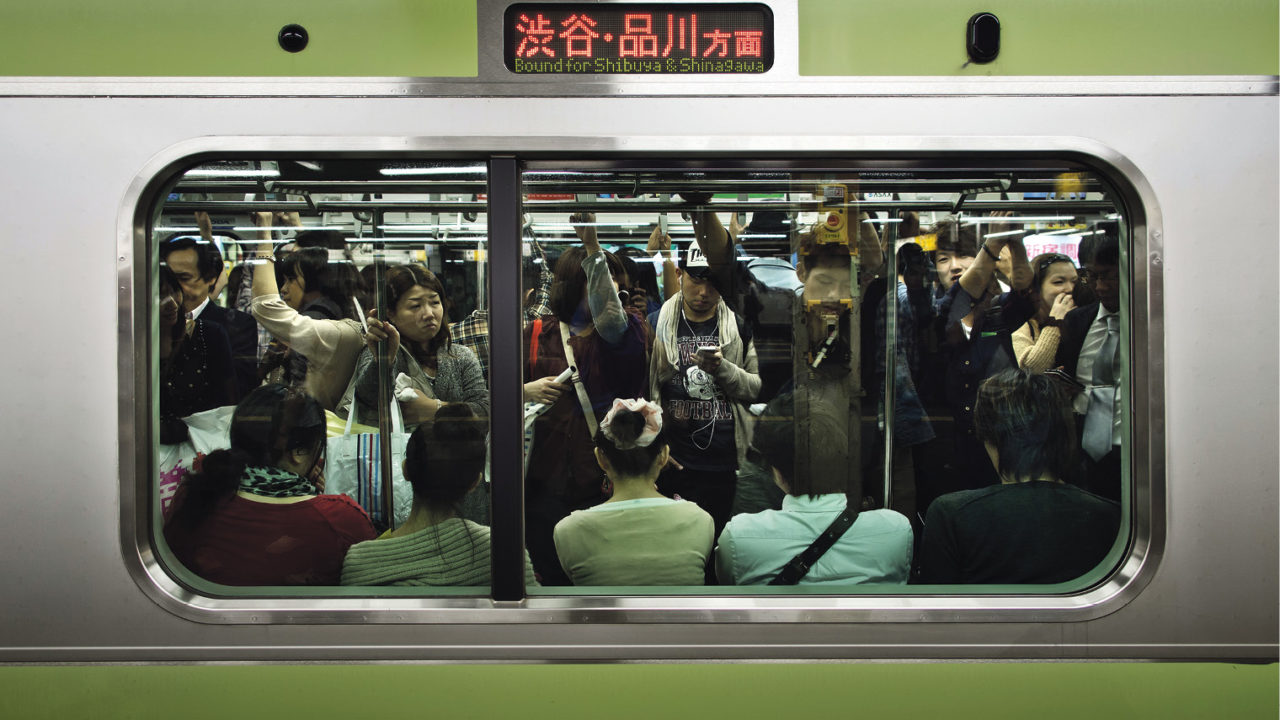 work in Japan: busy metro train during commute