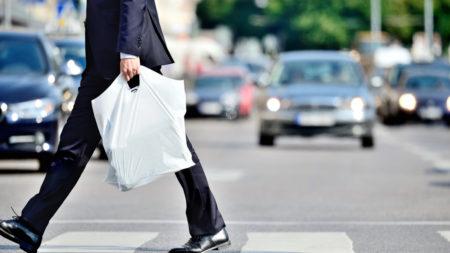 man with single-use plastic bag