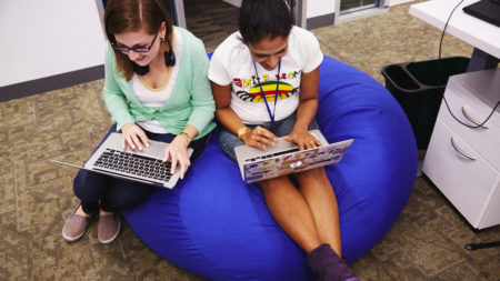 Women on beanbags with laptops diversity in tech