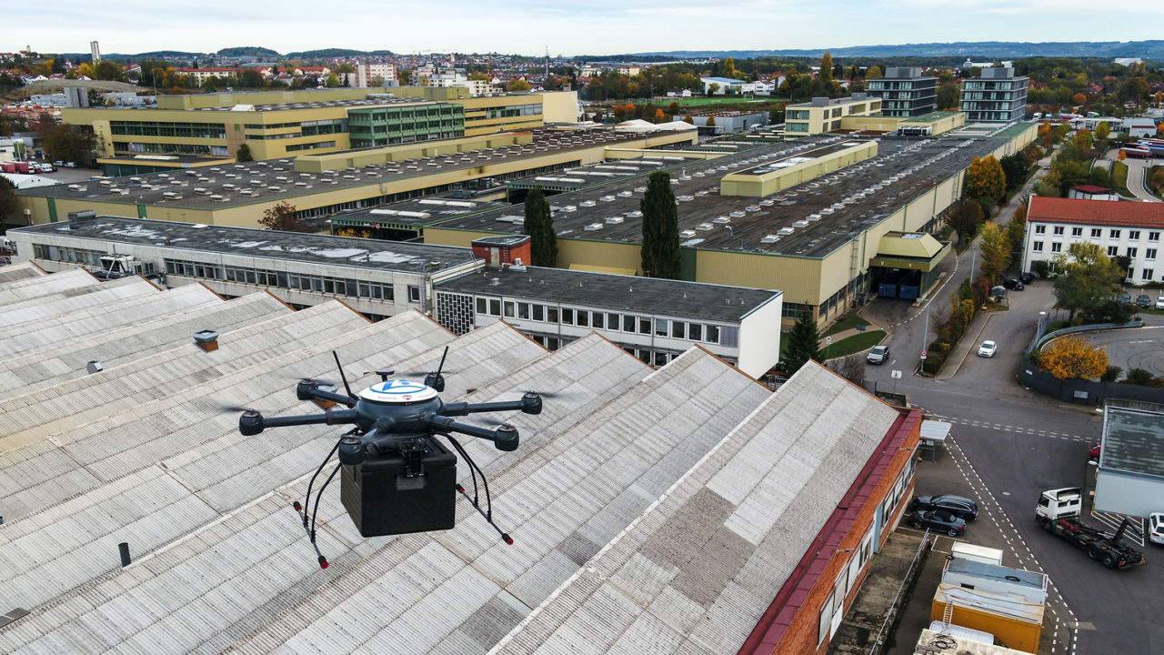 drone flying over warehouse