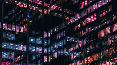 office building at night with purple and blue windows