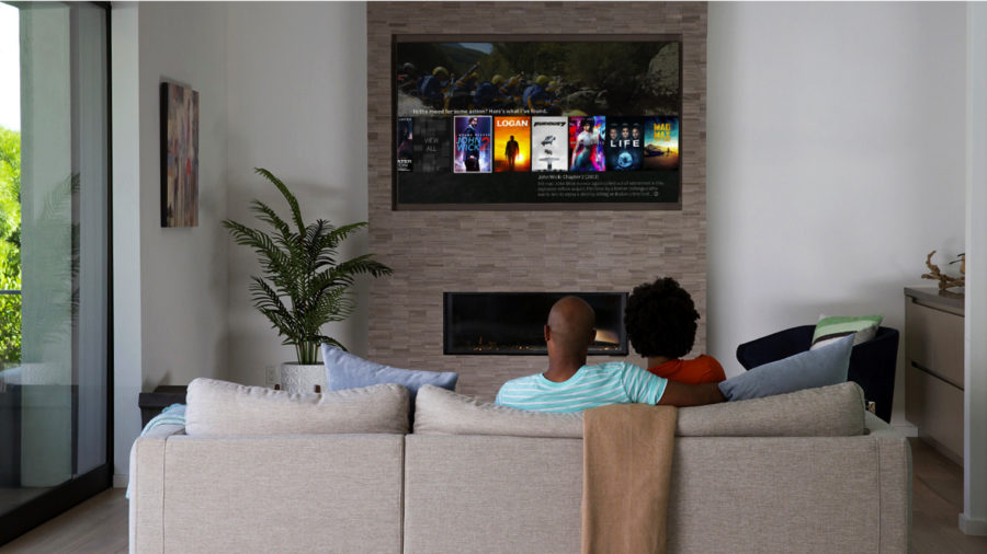 Couple watching TiVo recording on TV