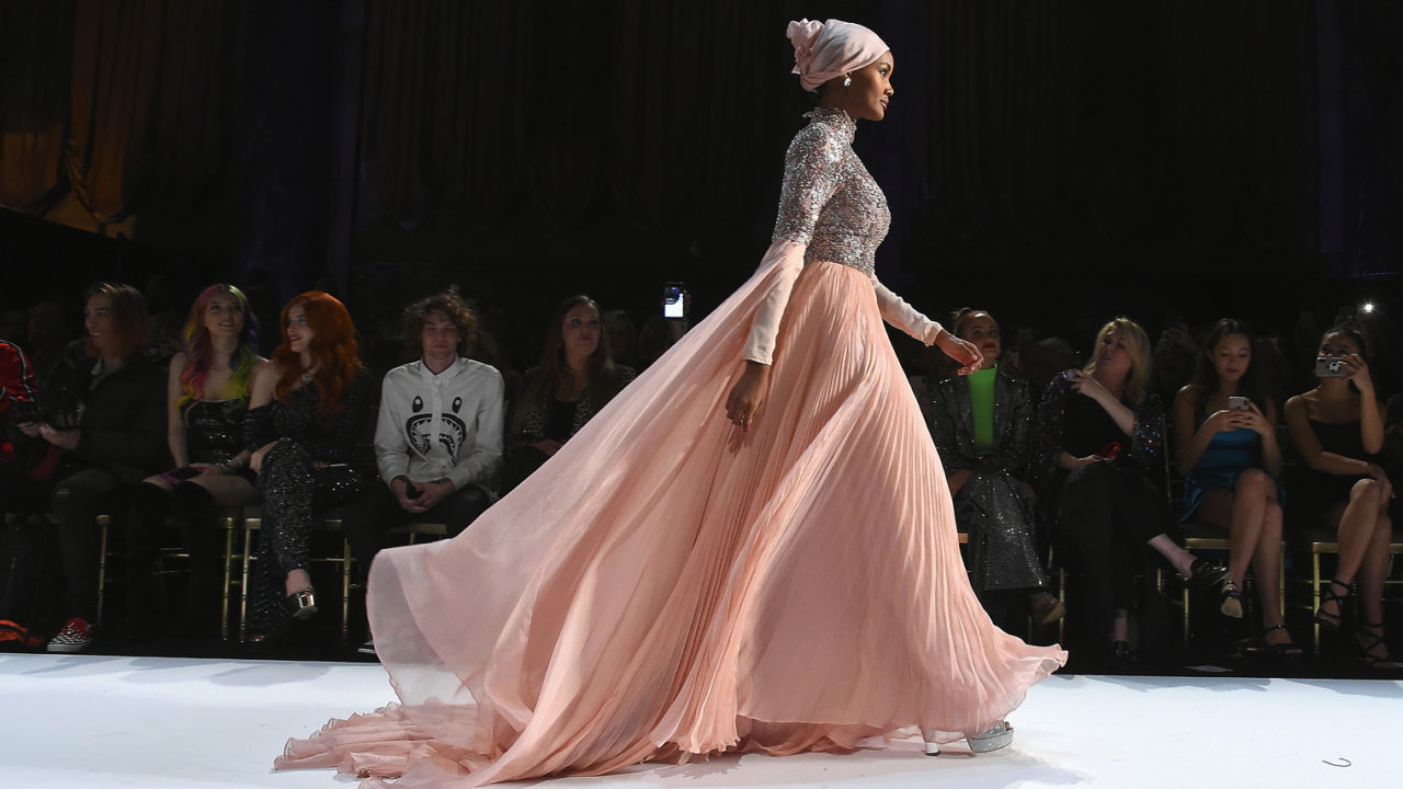 woman in modest fashion on the catwalk