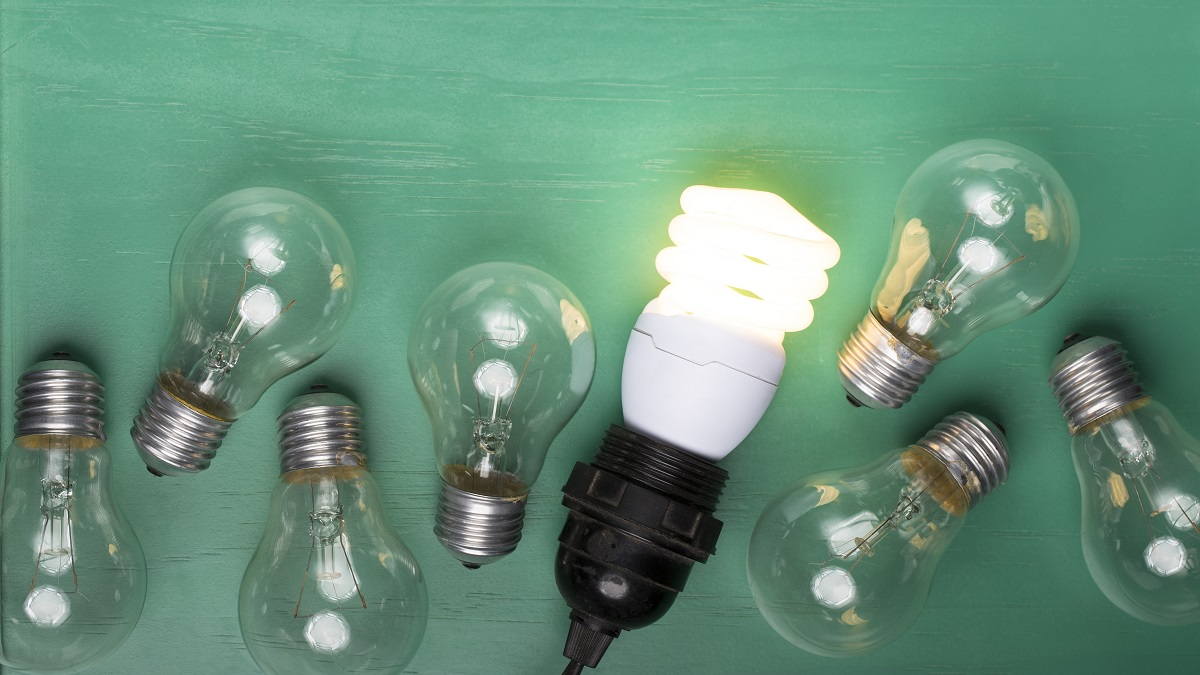 Filament lightbulbs next to one LED lightbulb