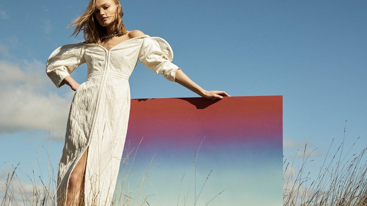 Net a Porter press image of model in dress by blue sky