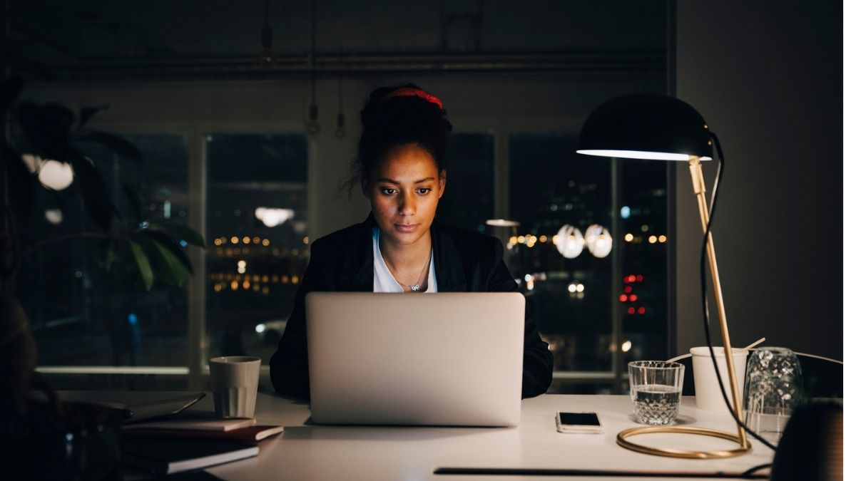 Woman working late at office desk