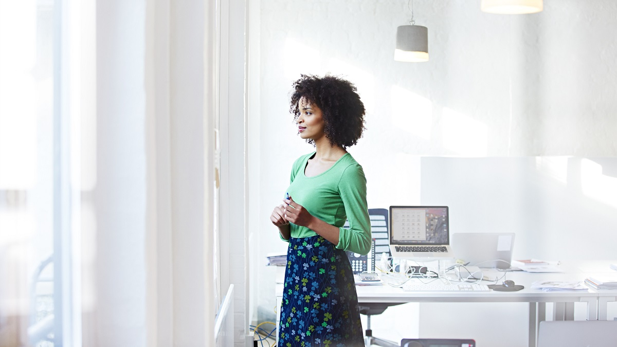 Woman in office looking out of a window